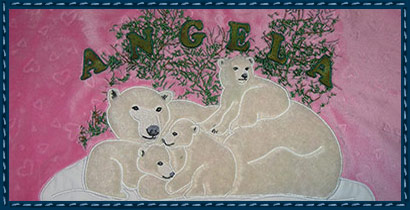 After Digitizing: Father asked for a throw for her bed.  The polar bears were appliqued with faux fur and her name added for the finishing touch.