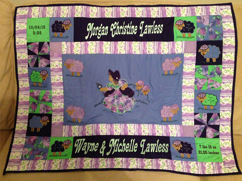 Little Bo Peep baby's quilt with personalizations in the border and corner squares.
