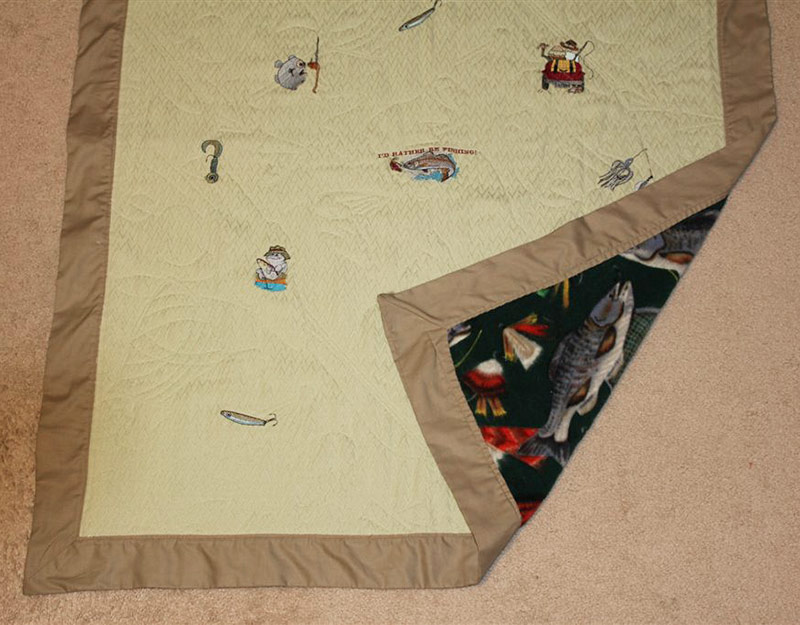 Fishing lures and small fishing designs were scattered around the quilt and quilted by tracing the fish on the fleece fabric.